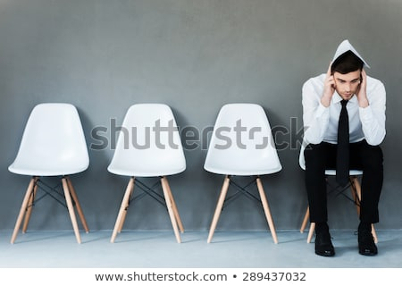 Foto d'archivio: Stressed Young Business Man Holding His Head At Interview