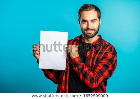 friendly businessman holding blank vertical billboard stock photo © lichtmeister