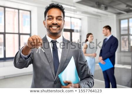Indiai üzletember ingatlanügynök üres iroda szoba Stock fotó © dolgachov