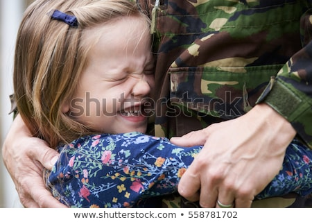 Soldier On Leave Being Hugged By Daughter Stock photo © HighwayStarz