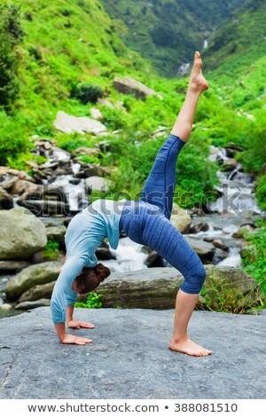Woman doing yoga asana at waterfall Stock photo © dmitry_rukhlenko
