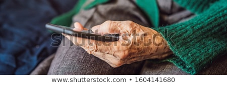 シニア 女性 携帯電話 座って ソファ バナー ストックフォト © galitskaya
