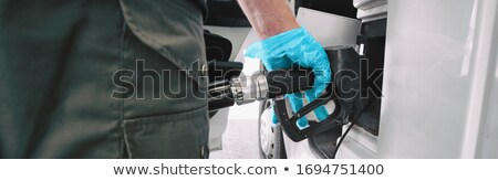 Gas pump Coronavirus outbreak protection gloves for touching handle while pumping gasoline at gas st Stock photo © Maridav