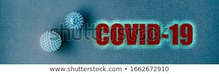 COVID-19 Text title header banner background for Coronavirus prevention with hospital doctor blue me Stock photo © Maridav