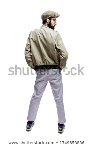 Young handsome man in casual clothes standing at full height, holding a mobile phone flat style Stock photo © robuart