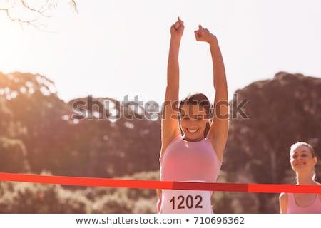 Siker karok a magasban női atléta útvonal gyönyörű Stock fotó © darrinhenry