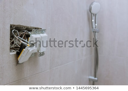 Electrician wiring a bathroom Stock photo © photography33