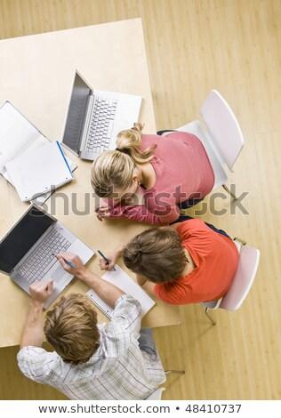 ernstig · team · tabel · pc · laptop · kantoor - stockfoto © photography33