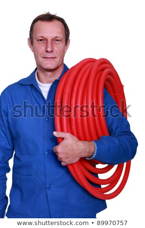 fully-fledged plumber carrying red hose Stock photo © photography33