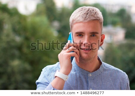 Grey-haired man making telephone call in park stock photo © photography33