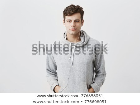 casual young man with hand in pocket and in hair Stock photo © feedough