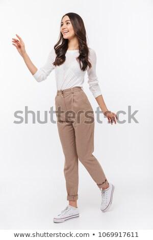 kadın · oturma · tablo · işaret · parmak · uzak - stok fotoğraf © stockyimages