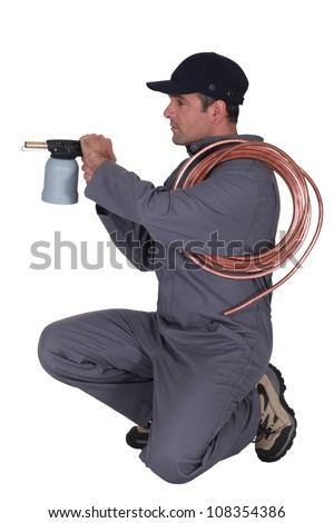 Man aiming gas nozzle. stock photo © iofoto