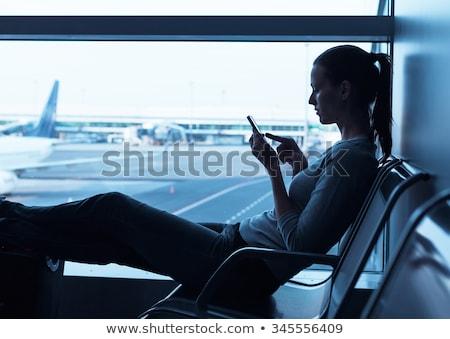 silhouette of woman playing the cell phone stock photo © konradbak