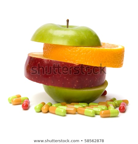 mixed sliced fruits and pills isolated on white background stock photo © natika