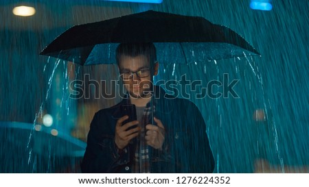 fiatalember · esernyő · izolált · fehér · mosoly · háttér - stock fotó © gemenacom