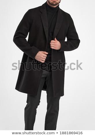 young business man wearing a long elegant coat stock photo © feedough