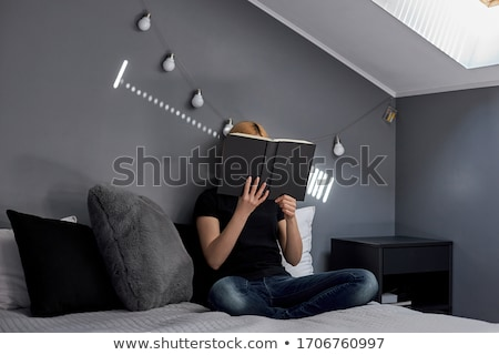 Blond Woman Leaning on her Hand on a Pillow Stock photo © juniart