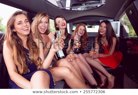 Beautiful blonde drinking champagne limousine  Stock photo © wavebreak_media