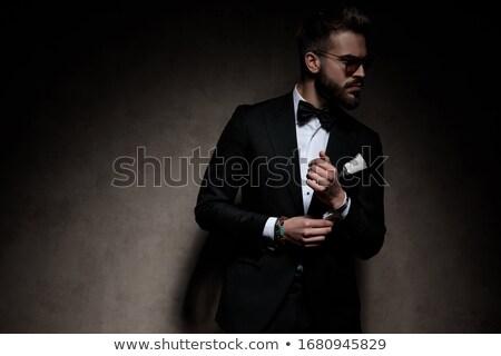 Jonge man studio smoking zonnebril Stockfoto © feedough