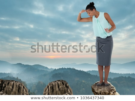 Foto stock: Businesswoman On Rock Mountain With A Tree