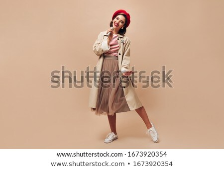 Sure, beautiful, snorting, stunning lady, woman, girl with good manners, gray beret, cap, red lips o stock photo © ANessiR
