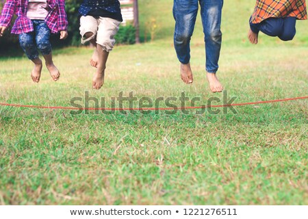 Fitnes, girl jumping over rope Stock photo © zurijeta
