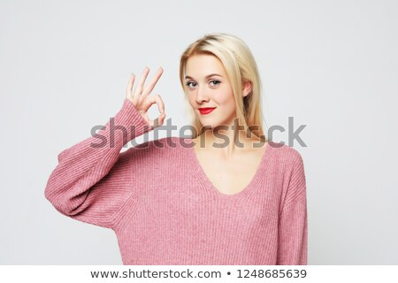 portrait of a cheerful girl showing ok sign with fingers stock photo © deandrobot