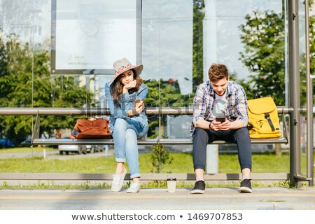 Stock photo: Young tourist waiting for the bus in the station for public tran