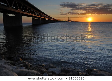 Foto stock: Rocks Sea And Oresund Bridge