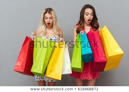 shocked young two ladies friends with bright makeup lips stock photo © deandrobot