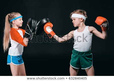 boy in boxing gloves isolated on black, active kids concept Stock photo © LightFieldStudios