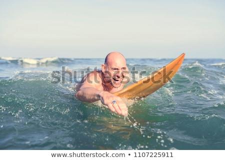 Supérieurs homme planche de surf rive Photo stock © wavebreak_media