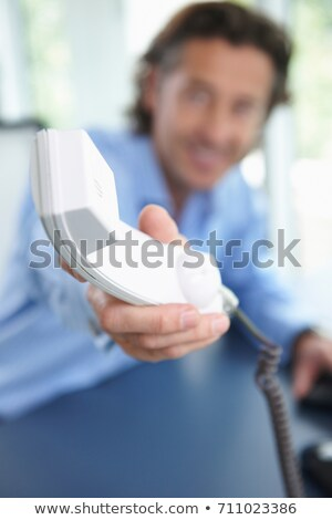 Man passing the phone, close up on horn Stock photo © IS2