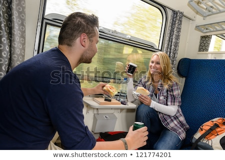 Happy couple traveling in train compartment Stock photo © jossdiim