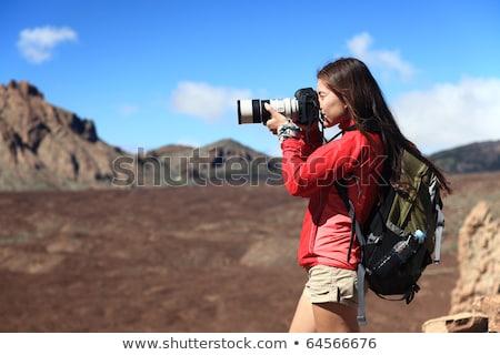 Fiatal fotós digitális fényképezőgép dslr hatalmas teleobjektív Stock fotó © lightpoet