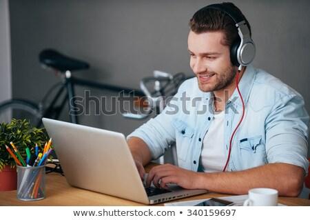 Mosolyog férfi zenét hallgat számítógéphasználat fejhallgató fából készült Stock fotó © AndreyPopov