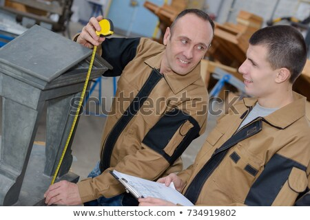 Macro of engineer recording measurements with assistant stock photo © lichtmeister