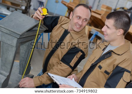 Macro of engineer measuring with assistant Stock photo © lichtmeister