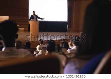 Elöl kilátás félvér üzletember áll pódium Stock fotó © wavebreak_media