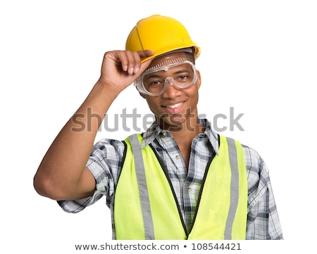 Young cheerful engineer or foreman in protective helmet and workwear Stock photo © pressmaster