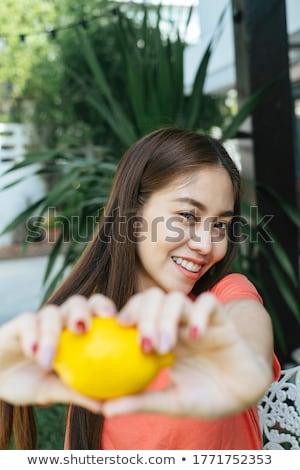 Görüntü genç esmer Asya kadın uzun saçlı Stok fotoğraf © deandrobot