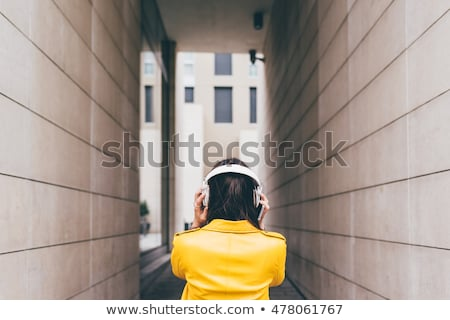 brown-haired girl listening to music Stock photo © photography33