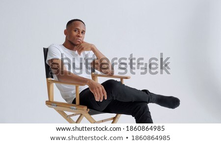 Portrait of a young business man isolated on black background. Studio shot. Stock photo © alexandrenunes
