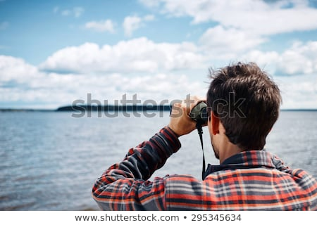 Man with binoculars in the countryside Stock photo © photography33