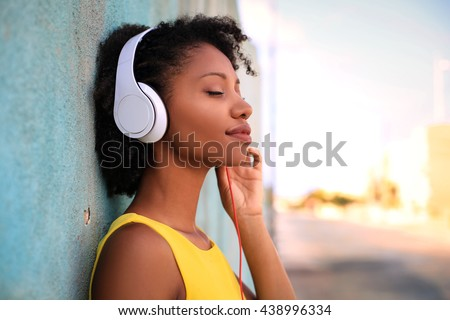 woman listening to music stock photo © ariwasabi
