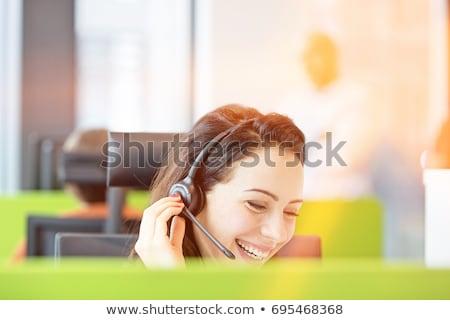 Sorridente empresária fone isolado branco mulher Foto stock © wavebreak_media