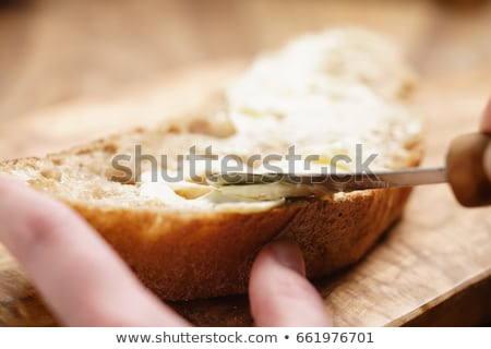 Girl eating slice of buttered bread Stock photo © photography33