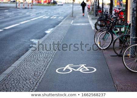 white cycle lane sign on asphalt stock photo © latent