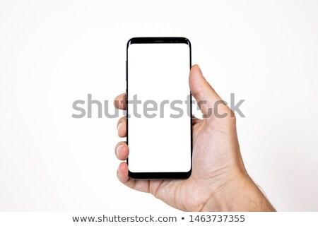 Człowiek komórkowej młodych biznesmen wzywając telefon komórkowy Zdjęcia stock © Kurhan